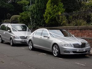 A mercedes s class and a Mercedes viano dressed as wedding cars
