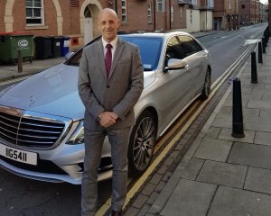 Picture of the owner of Executive Cars York Mark Heaney Next To Our Mercedes s Class