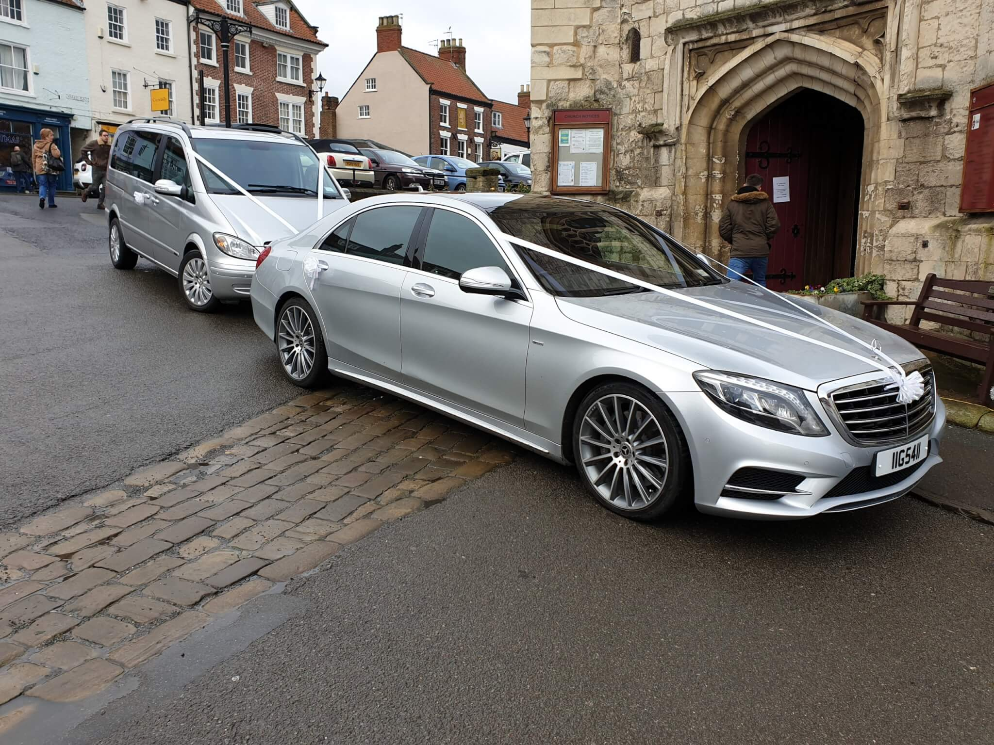 2 Silver Mercedes Wedding Cars Outside a Church In Malton