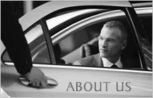 Chauffeur opening rear door for customer